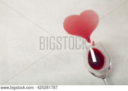 Wooden Floor With Overturned Glass Of Red Wine. Spilled Wine On A Wooden Laminate Parquet Floor With