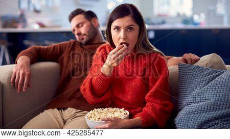 Man Falls Asleep As Couple Sit On Sofa With Popcorn Watching TV