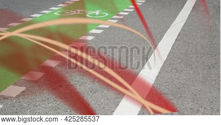 Red digital waves against close up view of pedestrian crossing on the road. acceleration speed motion and technology concept