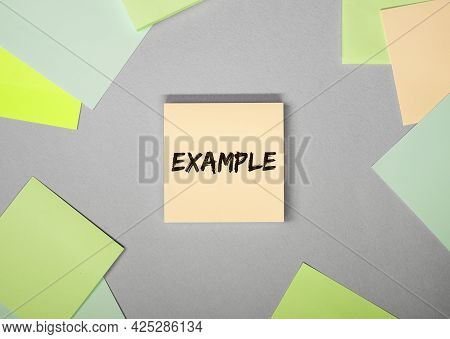 Example Word On Sticky Note On Grey Background.
