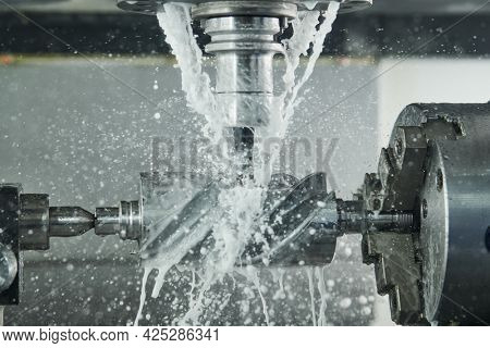 Milling process. Industrial CNC metal machining by vertical mill. Coolant