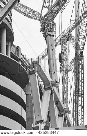 Telescopic Cranes In The City. Construction Engineering Industry. Black White