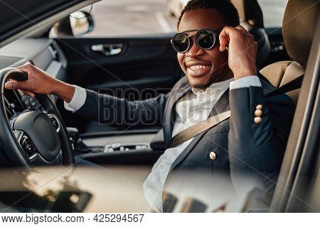 Joyful Businessman Of African Descent With Phone