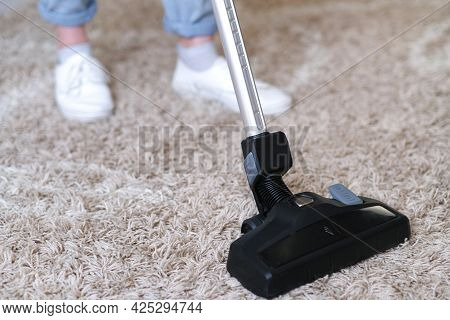 Cordless Vacuum Cleaner Is Used To Clean The Carpet In The Room. Housework With A New Handheld Vacuu