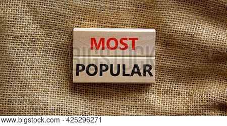 Most Popular Symbol. Concept Words Most Popular On Wooden Blocks On A Beautiful Canvas Background. C