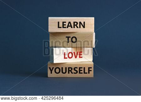 Learn To Love Yourself Symbol. Concept Words 'learn To Love Yourself ' On Wooden Blocks On A Beautif