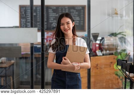 Startup Successful Small Business Owner Woman Beauty Girl Standing In Coffee Shop Restaurant. Portra