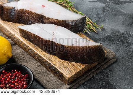 Fresh Steak Raw Fish Halibut Set, With Ingredients And Rosemary Herbs, On Gray Stone Table Backgroun