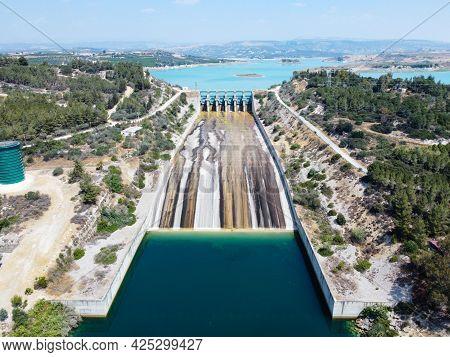 Aerial View Of Water Reservoir, Concrete Rapid And Closed Reservoir Locks Of A Dam. Berdan Dam, Tars