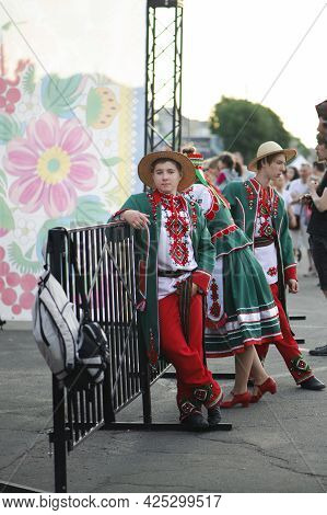 A Series Of Photographs With Ukrainian Costumes. Young Guy In Ukrainian Embroidered Shirt. Holiday,