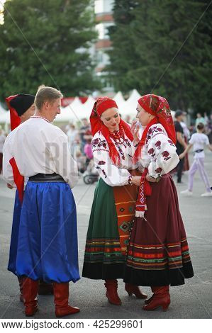 A Series Of Photographs With Ukrainian Costumes. Man And Young Woman In Ukrainian Embroidered Clothe
