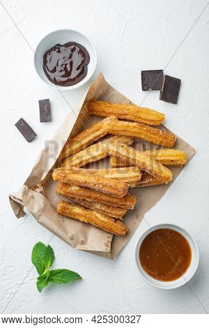 Churros With Caramel, Traditional Spanish Cusine, On White Background, Top View Flat Lay