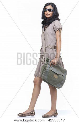 girl holding shoulder bag