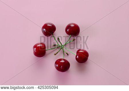 Ripe Cherries On A Pink Background. Pop Art