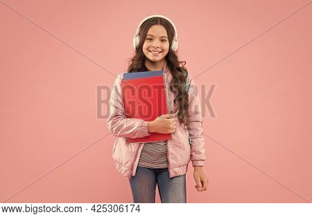 Lets You Speak English Better. Happy Child Hold Books Wearing Headphones. English Learning School. L