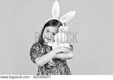 Easter Bunny Kid. Small Girl Hold Hare Toy. Happy Childhood. Cute Child Play With Toy. Toy Shop Conc