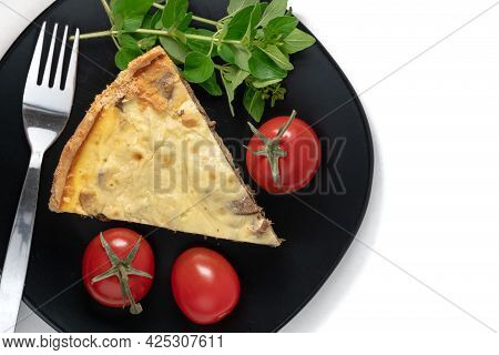 Top View Studio Shot Of A Slice Of Yellow French Salty Cake, Or Quiche, With Mushrooms On A Black De