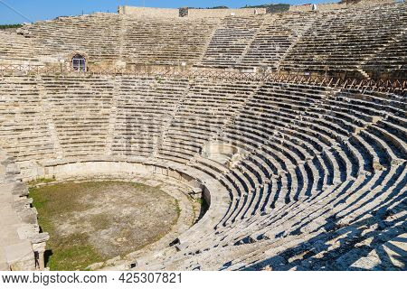 Panoramic View Onto Well Preserved Theater In Antique City Hierapolis, Pamukkale, Turkey. There Are