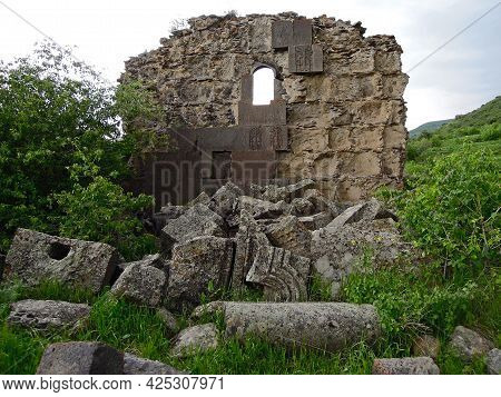 Ruined Wall Of The Medieval Monastery Havuts Tar With The Traditional Decorations As Khachkars, And