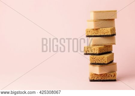 Set Of Beige Color Household Sponges On Pale Pink Background, Concept Of Cleaning Service, Annual Sp