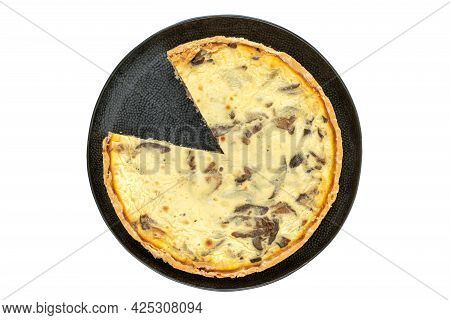 Top View Studio Shot Of Freshly Baked Yellow French Salty Cake, Or Quiche, With Mushrooms On A Black