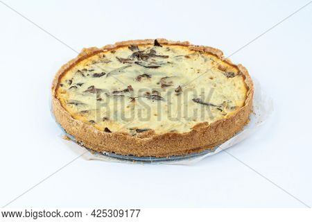 Studio Shot Of Freshly Baked Yellow French Salty Cake, Or Quiche, With Mushrooms, On A Baking Paper,