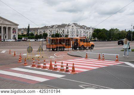 Ukraine, Chernigov, June 11, 2021: Repair Of Roads In The City, Workers Apply Road Markings In The C