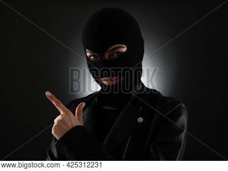 Woman Wearing Knitted Balaclava On Black Background