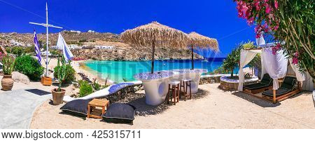Greece summer vacation. Luxury greek holidays. Stunning Mykonos island. famous Super Paradise beach with relaxing bar' zone