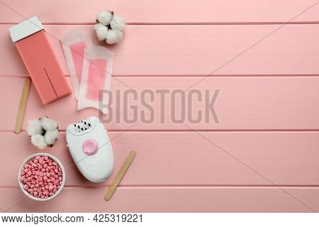 Set Of Epilation Products On Pink Wooden Table, Flat Lay. Space For Text