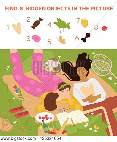 Teenage Girls And Cat Lying On Grass In Park. Young Girls On Picnic In Nature. They Relax, Eat Straw