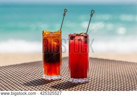 Refreshing Exotic Colorful Cocktails On Table At Sea Shore, Summer Vacations Concept. Fresh Cool Ras