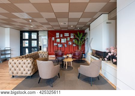 Breda / Netherlands - June 22, 2021: Furnished Sitting Area Or Waiting Area With Comfortable Chairs