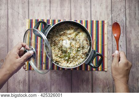 Mutton Biryani Meal In A Bowl On Table.
