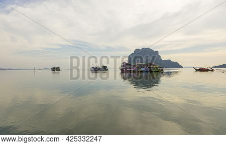 Pristine View Of Fisherman Boat Resting At Pak Meng Pier In Trang, Thailand.