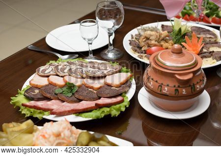 Meat Appetizer Of Smoked Beef, Horse Meat, Turkey On The Banquet Table