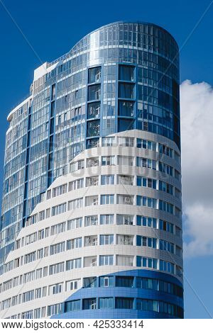 Krasnodar, Krasnodar Territory, Russia, June 11, 2021: A Modern Multi-storey Building In The Form Of
