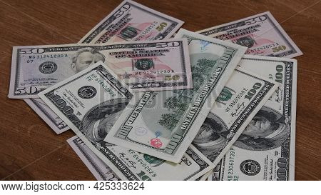Flat Lay American Cash Banknotes 50 Dollar And 100 Dollar Bills Marked By Inked Symbols. Red Ink Str