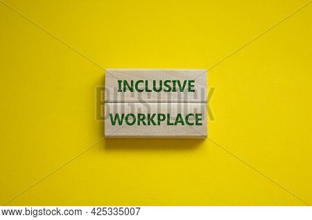 Inclusive Workplace Symbol. Wooden Blocks With Words Inclusive Workplace On Beautiful Yellow Backgro