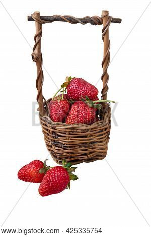 Wicker Basket Filled With Red Ripe Strawberries Isolated On White