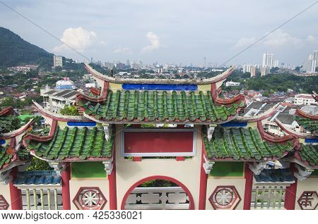 A Traditional Chinese Style Gate With The City Of Air Itam In Penang Malaysia In The Background.