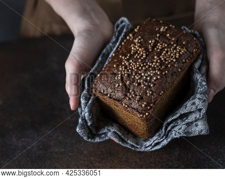 Traditional Russian Rye Borodino Bread. Female Baker Holds Home Made Artisan Organic Bread Fresh Fro