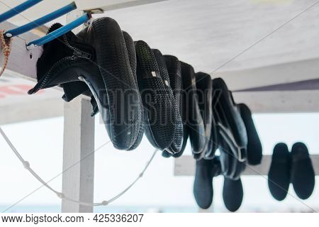 Diving Shoes Are Drying. Underwater Swimming Equipment. Rubber Diving Boots
