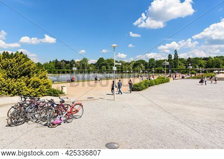 Worclaw, Poland - June 6, 2021: Tourists Watch The Show At Pergola - Wroclaw Multimedia Fountain