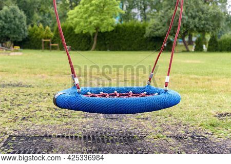 Modern Empty Swing Made Of Ropes On The Playground