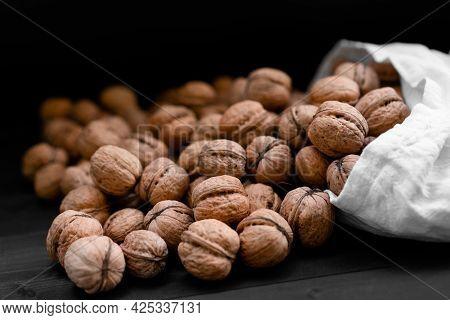 Ripe Walnuts On Wooden Background.ripe Walnuts On Wooden Background