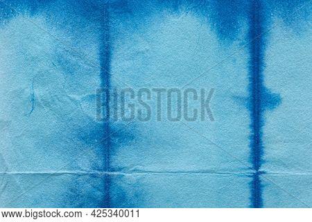 Indigo shibori textured blue background