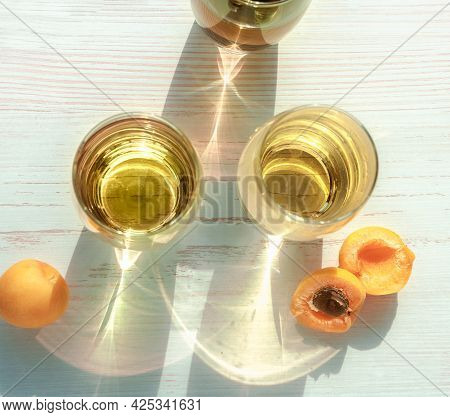 Glasses Of Lemonade With Apricots. Top View Of Glasses With Lemonade And Fruit Of Apricot. Caustic R