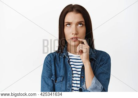 Let Me Think. Serious Woman Multiplaying In Mind, Looking Up Thoughtful And Bite Finger, Ponder Smth