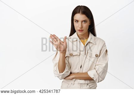 No, Enough Stop It. Serious Brunette Woman Wave Hand In Refusal, Rejecting Smth, Declining, Unwillin